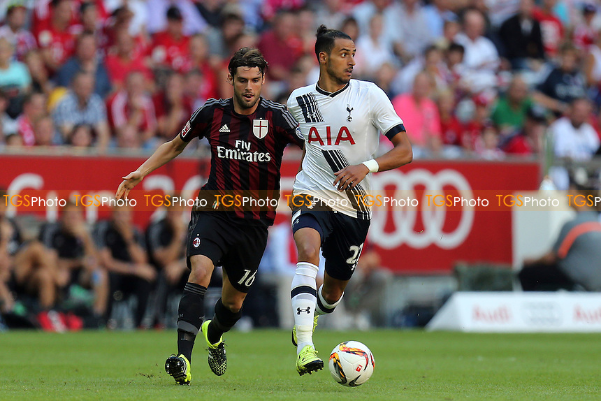 Nacer Chadli of Tottenham and Andrea Poli of AC Milan