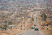 A sprawling settlement of houses, cut by a single road, is seen on the dusty hillsides of Pachacútec, a desert suburb of Lima, Peru, 24 January 2015. Although Latin America (as a whole) is blessed with an abundance of fresh water, having 20% of global water resources in the the Amazon Basin and the highest annual rainfall of any region in the world, an estimated 50-70 million Latin Americans (one-tenth of the continent's population) lack access to safe water and 100 million people have no access to any safe sanitation. Complicated geographical conditions (mainly on the Pacific coast), unregulated industrialization (causing environmental pollution) and massive urban poverty, combined with deep social inequality, have caused a severe water supply shortage in many Latin American regions.