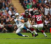 26.10.2014.  London, England.  NFL International Series. Atlanta Falcons versus Detroit Lions.  Lions' QB Matthew Stafford [9] scrambles for yardage.