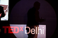 A shadow of Peter Singer as he speaks on stage at the India Islamic Cultural Centre during the TEDxChange @ TEDxDelhi in New Delhi, India on 22nd March 2011..