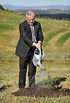 Michel Sleiman, President of Lebanon, waters in a Lebanese cedar tree after a planting ceremony at the Canberra arboretum, Canberra, on Monday April 16th 2012. AFP PHOTO / Mark GRAHAM POOL