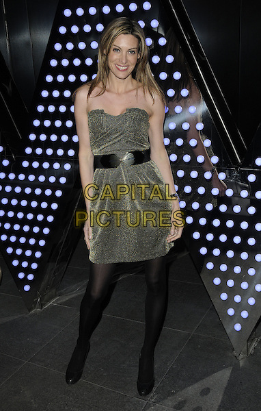CATHERINE McQUEEN.The W London Leicester Square hotel launch party, Wardour St., London, England..March 16th, 2011.full length black belt tights green gold strapless dress.CAP/CAN.©Can Nguyen/Capital Pictures.