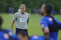 QPR assistant Kevin Bond watch the first team train