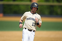 Keegan Maronpot (13) of the Wake Forest Demon Deacons hustles towards third base against the Pitt Panthers at David F. Couch Ballpark on May 20, 2017 in Winston-Salem, North Carolina. The Demon Deacons defeated the Panthers 14-4.  (Brian Westerholt/Four Seam Images)