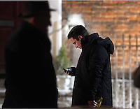 Pictured: Elijah Wood on his mobile phone during a break. Tuesday 11 February 2014<br />