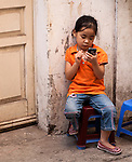 Keeping In Touch - Young Vietnamese girl using a smart phone, Tam Thuong Lane, Hanoi Old Quarter, Vietnam