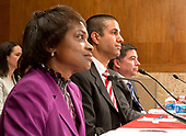 From left to right: Mignon Clyburn, Commissioner<br /> Federal Communications Commission (FCC); Ajit Pai, Chairman, FCC; and Michael O'Rielly, Commissioner, FCC, appear before the United States Senate Committee on Appropriations Subcommittee on Financial Services and General Government to examine proposed budget estimates and justification for the fiscal year 2018 FCC budget request on Capitol Hill in Washington, DC on Tuesday, June 20, 2017.<br /> Credit: Ron Sachs / CNP