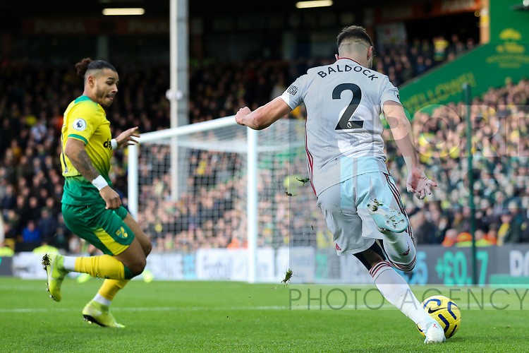 George Baldock (r) of Sheffield United crosses the ball during the Premier League match at Carrow Road, Norwich. Picture date: 8th December 2019. Picture credit should read: James Wilson/Sportimage