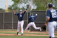 San Diego Padres first baseman Blake Hunt (12) stretches to make a catch ahead of Luis Joseph (28) during a Minor League Spring Training game against the Seattle Mariners at Peoria Sports Complex on March 24, 2018 in Peoria, Arizona. (Zachary Lucy/Four Seam Images)