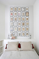 In the guest room a collection of posters by the artist Paella Chimicos covers an entire wall behind the bed