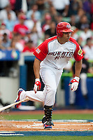 11 March 2009: #15 Carlos Beltran of Puerto Rico runs as he hits the ball during the 2009 World Baseball Classic Pool D game 6 at Hiram Bithorn Stadium in San Juan, Puerto Rico. Puerto Rico wins 5-0 over the Netherlands