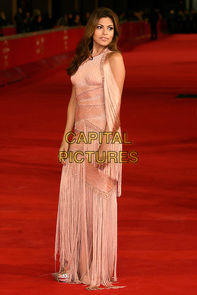 "EVA MENDES.(in a Versace dress).at the premiere of ""Le Petit Mouchoirs"".during Rome International Film Festival, .Rome, Italy,  29th October 2010..full length peach coral tassels fringe long maxi gown off the shoulder pink  .CAP/PE.©Peter Eden/Capital Pictures."