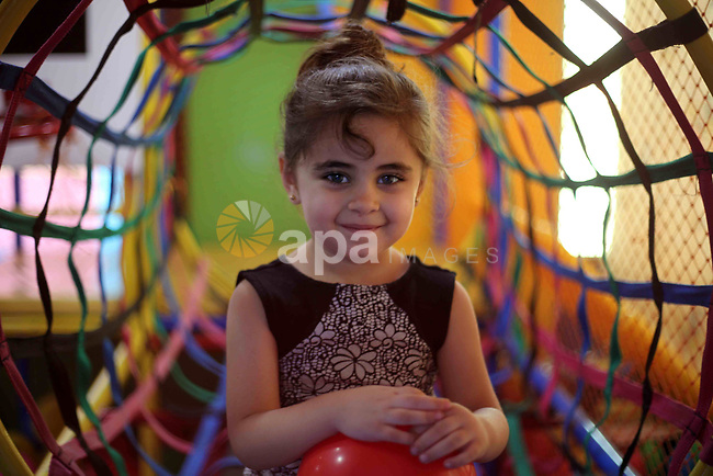 Palestinian children celebrate on the second day of Eid al-Fitr holiday which marks the end of the Muslim holy month of Ramadan in Gaza city June 16, 2018. Eid al-Fitr marks the end of Muslim's holy fasting month of Ramadan when faithfuls abstain from eating, drinking, smoking and sexual activities from dawn to dusk. Photo by Mahmoud Ajour