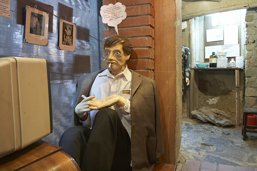 The coca museum in La Paz, Bolivia.  Diorama of a cocaine addict in front of a television.