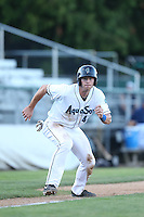Kyle Petty #44 of the Everett AquaSox leads off of third base during a game against the Tri-City Dust Devils at Everett Memorial Stadium on July 29, 2014 in Everett, Washington. Everett defeated Tri-City, 7-5. (Larry Goren/Four Seam Images)