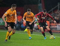Bournemouth's Diego Rico (right) under pressure from Wolverhampton Wanderers' Matt Doherty (left)<br /> <br /> Photographer David Horton/CameraSport<br /> <br /> The Premier League - Bournemouth v Wolverhampton Wanderers - Saturday 23rd November 2019 - Vitality Stadium - Bournemouth<br /> <br /> World Copyright © 2019 CameraSport. All rights reserved. 43 Linden Ave. Countesthorpe. Leicester. England. LE8 5PG - Tel: +44 (0) 116 277 4147 - admin@camerasport.com - www.camerasport.com