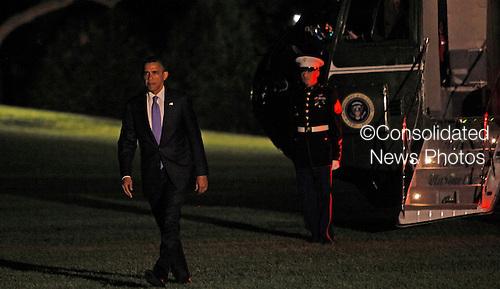 United States President Barack Obama returns to the White House on July 30,2012..Credit: Dennis Brack / Pool via CNP