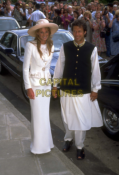 JEMIMA & IMRAN KHAN.Ref: 1315.traditional dress, big hat, wedding, cricketer, jemima goldsmith, full length, full-length.*RAW SCAN - photo will be adjusted for publication*.www.capitalpictures.com.sales@capitalpictures.com.© Capital Pictures