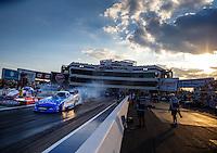 Sep 16, 2016; Concord, NC, USA; NHRA funny car driver Tommy Johnson Jr does a burnout during qualifying for the Carolina Nationals at zMax Dragway. Mandatory Credit: Mark J. Rebilas-USA TODAY Sports