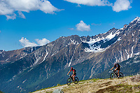 Austria, East-Tyrol: mountainbiking near Staller Sattel passroad below Riesenferner Group mountains, Italian-Austrian border connecting Valle di Anterselva with Defereggen Valley, winter closure between end of October and mid of May | Oesterreich, Ost-Tirol: Mountainbiking beim Staller Sattel,  dem Grenzuebergang Italien-Oesterreich unterhalb der Riesenfernergruppe, er verbindet das Antholzer Tal mit dem Defereggental, Wintersperre Ende Oktober bis Mitte Mai