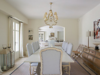 An archway opens on to the living room at the far end of the long dining table