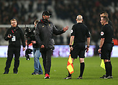 4th February 2019, London Stadium, London, England; EPL Premier League football, West Ham United versus Liverpool; A disappointed Liverpool Manager Jurgen Klopp talking to Referee Kevin Friend and Assistant Referees Matthew Wikes and Simon Beck at full time
