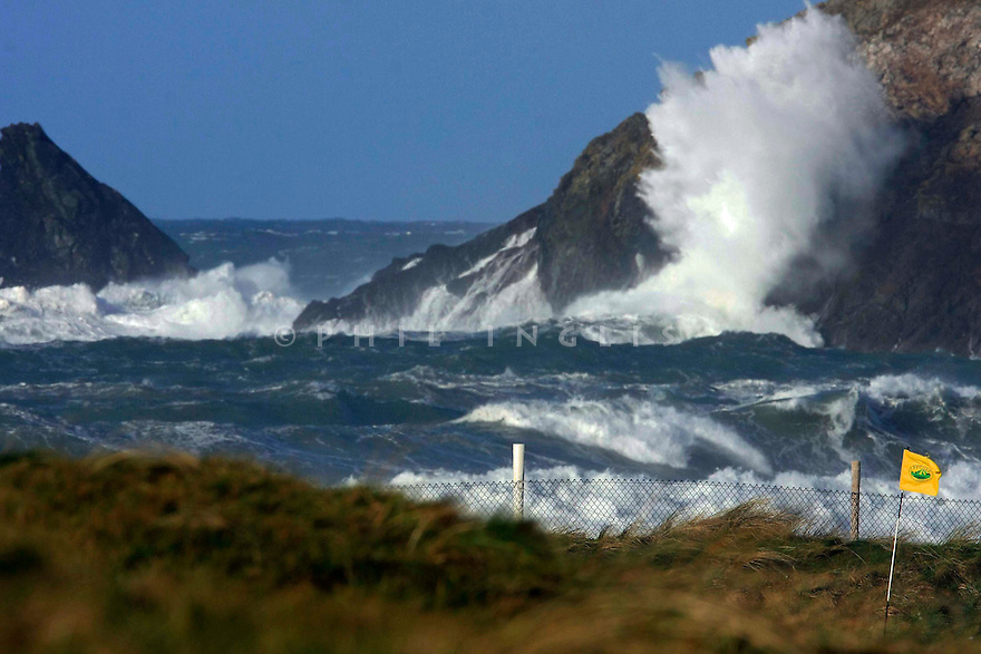 A view of the flag on the 4th green at Trevose Golf and Country Club, Padstow, Cornwall in high winds and stormy seas. ...