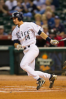J.T. Chargois #14 of the Rice Owls follows through on his swing against the Kentucky Wildcats at Minute Maid Park on March 4, 2011 in Houston, Texas.  Photo by Brian Westerholt / Four Seam Images