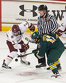 Austin Cangelosi (BC - 9), Kevin Briganti, Craig Puffer (UVM - 17) - The visiting University of Vermont Catamounts tied the Boston College Eagles 2-2 on Saturday, February 18, 2017, Boston College's senior night at Kelley Rink in Conte Forum in Chestnut Hill, Massachusetts.Vermont and BC tied 2-2 on Saturday, February 18, 2017, Boston College's senior night at Kelley Rink in Conte Forum in Chestnut Hill, Massachusetts.