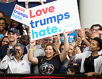 Fairfax, VA September 16, 2016, USA: Clinton supporters hold up signs at the campaign rally which  First Lady Michelle Obama appears on the campus of George Mason University in Fairfax, VA.  Patsy Lynch/MediaPunch