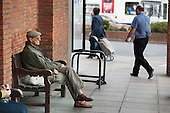 An elderly man sits on a bench in Margate town centre.