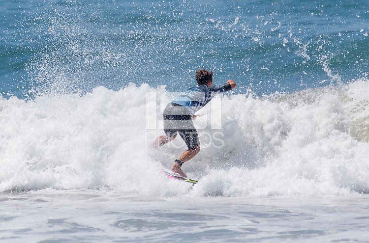 Huntington Beach, CA - Saturday August 4, 2018: Griffin Colapinto in action during a World Surf League (WSL) Qualifying Series (QS) Men's Round of 16 heat at the 2018 Vans U.S. Open of Surfing on South side of the Huntington Beach pier.