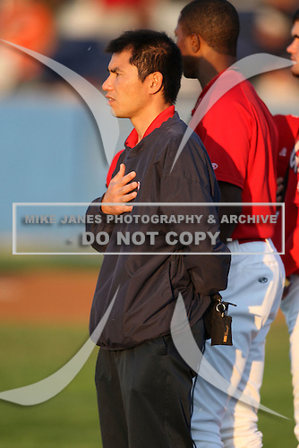 "September 5, 2009:  Trainer Manabu ""BU"" Kuwarzuru of the Batavia Muckdogs stands during the National Anthem before a game at Dwyer Stadium in Batavia, NY.  The Muckdogs are the Short-Season Class-A affiliate of the St. Louis Cardinals.  Photo By Mike Janes/Four Seam Images"
