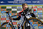 Marcel Kittel (GER) Team Giant-Shimano kisses the bike he threw down in anger after his fall near the end of yesterday's stage, before the start of Stage 3 of the 2014 Tirreno-Adriatico, running  from Càscina to Arezzo (210 km). 14th March 2014.      <br /> Photo: Gian Mattia D'Alberto/LaPresse/www.newsfile.ie