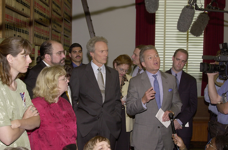 Eastwood C. 4(DG) 051800 -- Clint Eastwood and  Mark Adam Foley, R-FL., during a press conference on Americans with Disabilities Act.