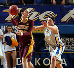 BROOKINGS, SD - MARCH 27:  Kayla Hirt #20 from the University of Minnesota looks to pass the ball away from Hannah Strop #14 from South Dakota State University in the first half of their sweet sixteen gameThursday night at Frost Arena in Brookings. (Photo by Dave Eggen/Inertia)