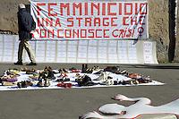 Roma, 25 Novembre 2012.Via dei Fori Imperiali.Giornata internazionale contro la violenza sulle donne.Le donne del Centro Donna L.I.S.A organizzan un flash Mob con scarpe in strada e i nomi delle donne uccise dalla violenza maschile