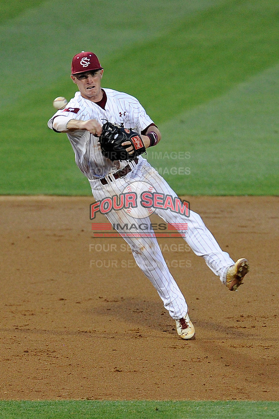 Shortstop Marcus Mooney (8) of the South Carolina Gamecocks fields a ground ball in an NCAA Division I Baseball Regional Tournament game against the Campbell Camels on Friday, May 30, 2014, at Carolina Stadium in Columbia, South Carolina. South Carolina won, 5-2. (Tom Priddy/Four Seam Images)