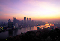 Allegheny River and bridges border the Golden Triangle in colorful sunrise. Pittsburgh Pennsylvania United States skyline.