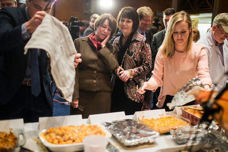 UNITED STATES - MARCH 8: Sen. Amy Klobuchar, D-Minn., left, and Betty McCollum, D-Minn., confer during the annual Minnesota Congressional Delegation Hotdish Competition in Dirksen Building, March 8, 2017. (Photo By Tom Williams/CQ Roll Call)