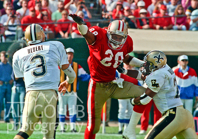 San Francisco 49ers vs. New Orleans Saints at Candlestick Park Sunday, November 15, 1992.  49ers Beat Saints 21-20.  San Francisco 49ers defensive back Dana Hall (28) jumps to block New Orleans Saints quarterback Bobby Herbert (3).