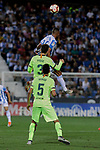 CD Leganes's Youssef En-Nesyri and FC Barcelona's Gerard Pique and Sergio Busquets during La Liga match between CD Leganes and FC Barcelona at Butarque Stadium in Madrid, Spain. September 26, 2018. (ALTERPHOTOS/A. Perez Meca)
