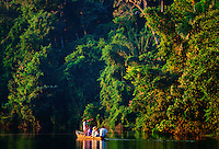 Tourists in a rowing boat with a tour guide on Lake Sandoval, Peruvian Rainforest, South America