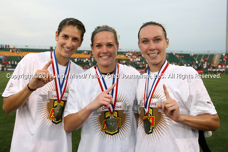 27 August 2011: University of North Carolina alums and New York Flash players Yael Averbuch, Ashlyn Harris, and Whitney Engen pose after the victory. Western New York Flash defeated the Philadelphia Independence 5-4 on penalty kicks to win the final after the game ended in a 1-1 tie after overtime at Sahlen's Stadium in Rochester, New York in the Women's Professional Soccer championship game.