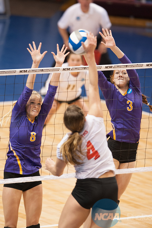 21 NOV 2015: Cal Lutheran's Jamie Smith, left and Sara Pappas attempt to block the spike attempt of Wittenberg's Melissa Emming during the Division III Women's Volleyball Championship held at Van Noord Arena on the Calvin University campus in Grand Rapids, MI. Cal Lutheran defeated Wittenberg 3-0 for the national title. Erik Holladay/NCAA Photos