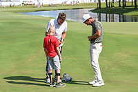 Ian Poulter (GBR) and Thorbjorn Olesen (DEN) autograph gloves and balls for a young St. Jude patient near the green on 18 following round 4 of the WGC FedEx St. Jude Invitational, TPC Southwind, Memphis, Tennessee, USA. 7/28/2019.<br /> Picture Ken Murray / Golffile.ie<br /> <br /> All photo usage must carry mandatory copyright credit (© Golffile | Ken Murray)