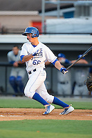 Brandon Thomasson (66) of the Burlington Royals follows through on his swing against the Bluefield Blue Jays at Burlington Athletic Park on June 29, 2015 in Burlington, North Carolina.  The Royals defeated the Blue Jays 4-1. (Brian Westerholt/Four Seam Images)