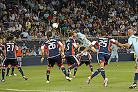 Jacob Peterson (37) forward Sporting KC has a header on goal..Sporting Kansas City and New England Revolution played to a 0-0 tie at LIVESTRONG Sporting Park, Kansas City, KS.