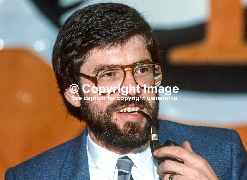Gerry Adams, Belfast, N Ireland, president, Provisional Sinn Fein, relaxes with his pipe, pre public smoking ban, on the platform at his party's annual conference, ard fheis 1984. 19840130GA5..Copyright Image from Victor Patterson, 54 Dorchester Park, Belfast, UK, BT9 6RJ..Tel: +44 28 9066 1296.Mob: +44 7802 353836.Voicemail +44 20 8816 7153.Skype: victorpattersonbelfast.Email: victorpatterson@me.com.Email: victorpatterson@ireland.com (back-up)..IMPORTANT: If you wish to use this image or any other of my images please go to www.victorpatterson.com and click on the Terms & Conditions. Then contact me by email or phone with the reference number(s) of the image(s) concerned.
