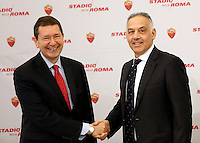 Il presidente della Roma James Pallotta stringe la mano al sindaco Ignazio Marino, a sinistra, durante la presentazione del progetto del nuovo Stadio della Roma, in Campidoglio, Roma, 26 marzo 2014.<br /> AS Roma president James Pallotta shakes hands with Mayor Ignazio Marino, left, during the presentation of the project of the AS Roma football club's new stadium at the Capitol Hill, Rome, 26 March 2014.<br /> UPDATE IMAGES PRESS/Riccardo De Luca